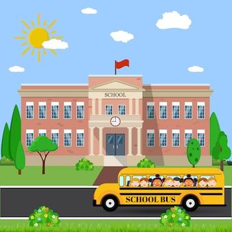 Budynek szkoły i autobus