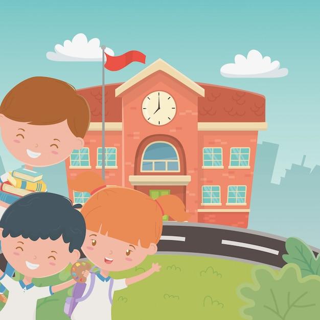 Budynek szkoły z dziećmi na scenie