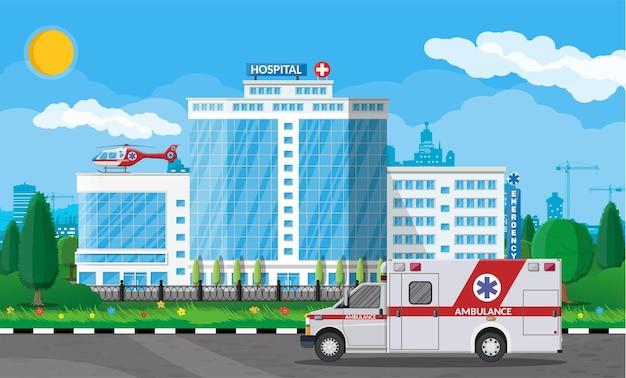Budynek szpitala. opieka zdrowotna, szpital i diagnostyka medyczna. pilne i ratunkowe służby. droga, niebo, drzewo. samochód i helikopter.