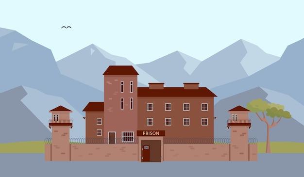 Budynek więzienia w górach fasada więzienia i więzienia z wieżą i ogrodzeniem