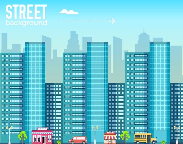 Budynek wieżowiec w przestrzeni miasta z drogą na tle płaski