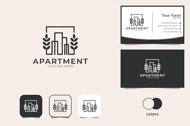 Budynek z projektem logo liścia i wizytówką. dobre wykorzystanie logo mieszkania
