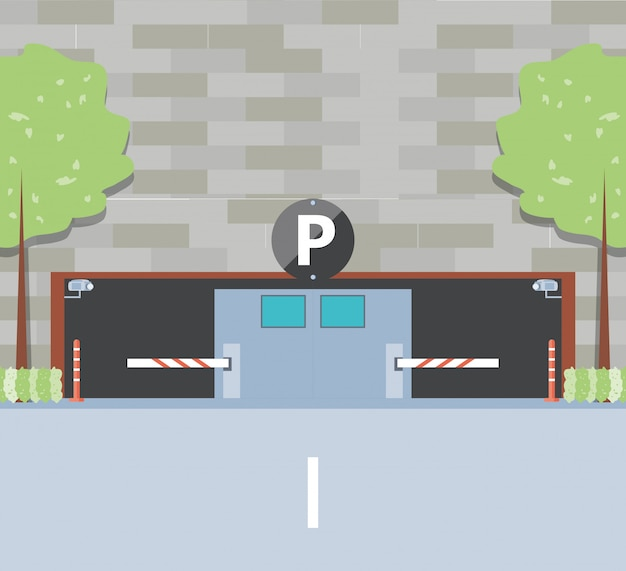 Budynek z wejściem do strefy parkowania i barykady