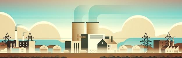 Budynki produkcyjne fabryki fabryki stref przemysłowych z rurami i kominami