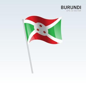 Burundi macha flagą na białym tle na szarym tle
