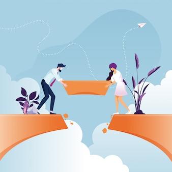 Business team building bridge nad przepaścią urwiska koncepcja pracy zespołowej firmy
