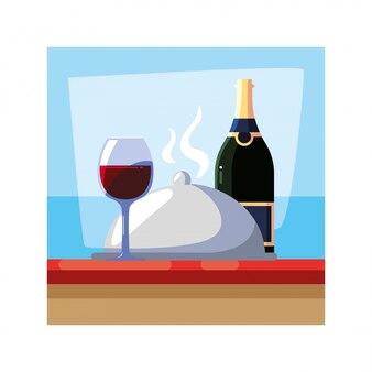 Butelka i kieliszek wina na stole