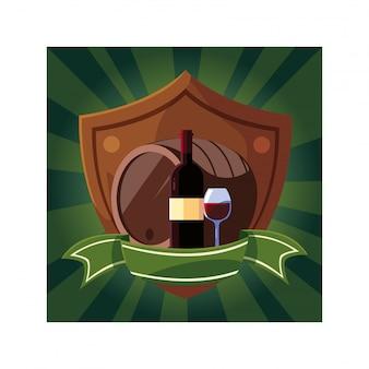 Butelka i kieliszek wina z beczką w tarczy ze wstążką