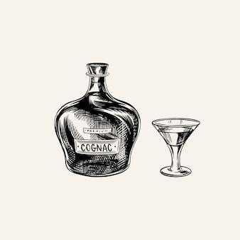 Butelka koniaku i szklany kielich. grawerowane ręcznie rysowane szkic vintage. styl drzeworyt. ilustracja.