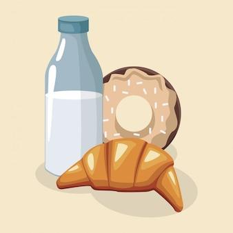 Butelka mleka ze słodkim pączkiem i rogalikiem