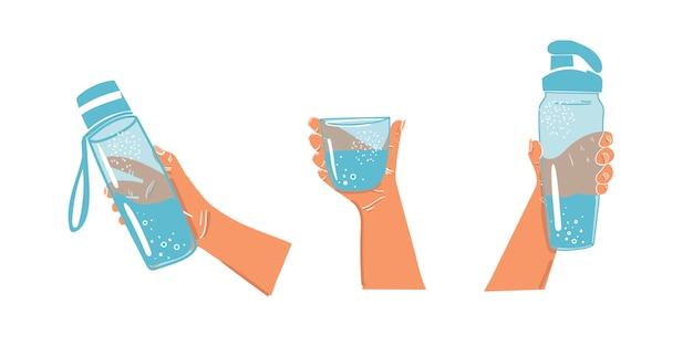 Butelka wody w ręku na na białym tle. dzienny bilans wodny. bidony sportowe. szklanka wody w dłoni. pij podczas uprawiania sportu.