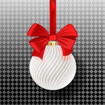 Cacko z białymi paskami wiszące na wstążce z czerwoną kokardą na białym tle.