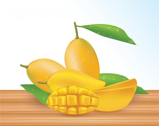 Całe żółte mango z pół liści na białym tle