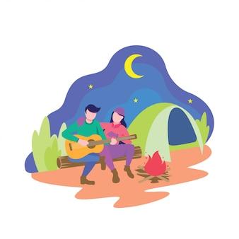 Camping na zewnątrz i gra na gitarze
