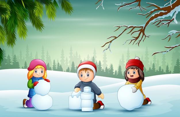 Cartoon dzieci bawiące się na śniegu