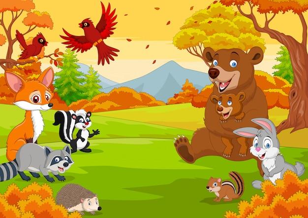Cartoon dzikich zwierząt w lesie jesienią