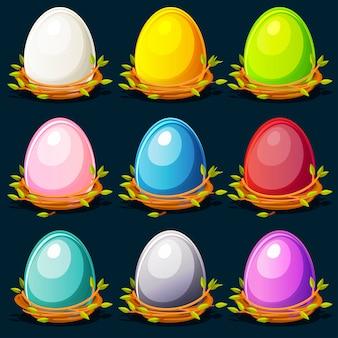 Cartoon śmieszne kolorowe ptaki jajka w gnieździe z gałązek