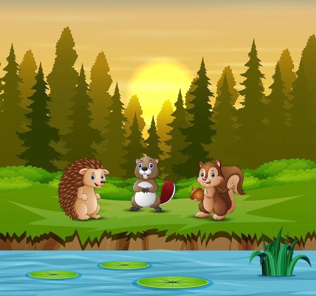 Cartoon wiele zwierząt nad rzeką