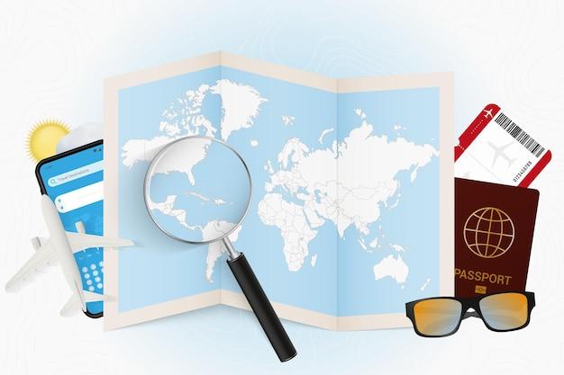 Cel podróży kuba, makieta turystyki z wyposażeniem podróży i mapa świata z lupą na kubie.