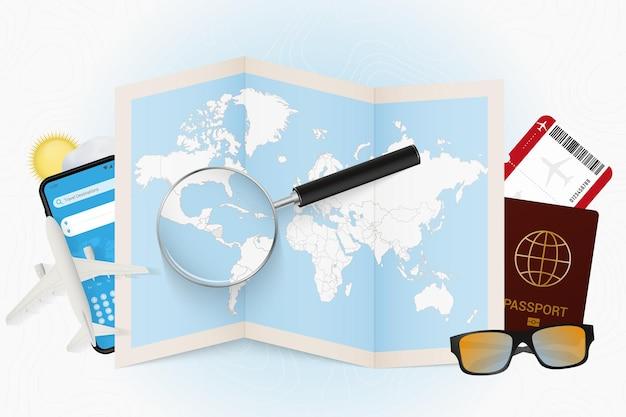 Cel podróży nikaragua, makieta turystyki z wyposażeniem podróży i mapa świata z lupą na nikaragui.