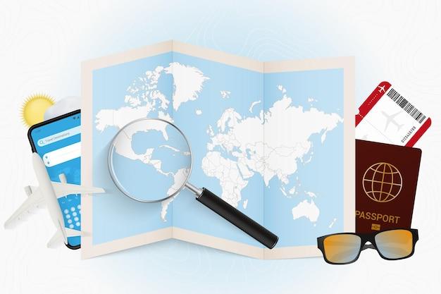 Cel podróży salwador, makieta turystyki z wyposażeniem podróży i mapa świata z lupą na salwadorze.