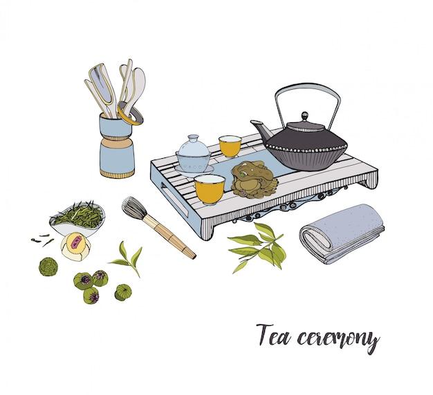 Ceremonia parzenia herbaty z różnymi tradycyjnymi elementami