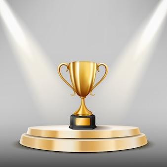 Champion trophy na scenie i podświetlane reflektory