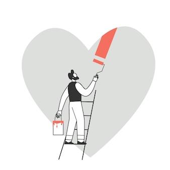 Charakter mężczyzny maluje serce. przygotowania do walentynki. koncepcja miłości i romansu.