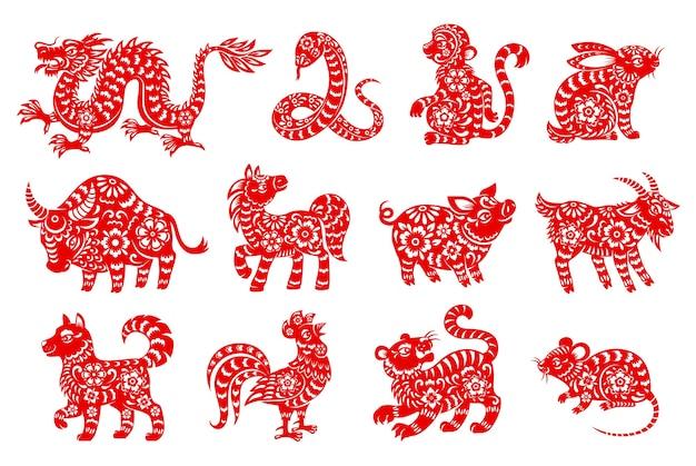 Chiński horoskop zwierzę na białym tle ikony z czerwonymi papierowymi symbolami zodiaku z księżycowego nowego roku