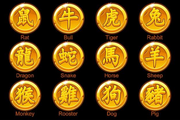 Chińskie znaki zodiaku hieroglify na złotych monetach