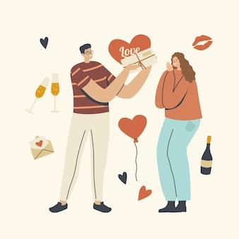 Chłopak daje prezent dziewczynie. postać szczęśliwego kochającego mężczyzny przygotuj prezent dla kobiety na randkę