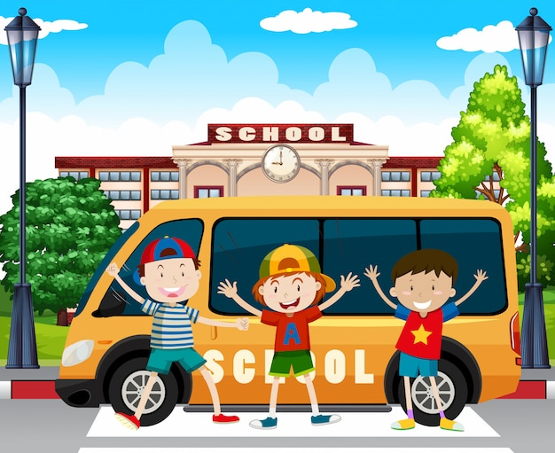 Chłopcy stojący przy szkolnej furgonetce
