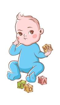 Chłopiec bawi się kostkami. zabawny, szczęśliwy, uroczy maluch w niebieskim kostiumie i blokach, postać z kreskówki