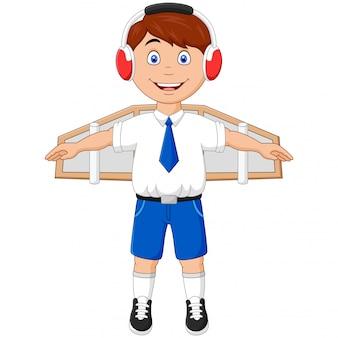 Chłopiec bawi się skrzydłami i marzy o pilotowaniu samolotu