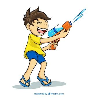 Chłopiec bawi się z pistoletem na wodę