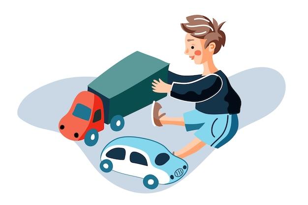 Chłopiec bawi się zabawkami samochodowymi ilustracji, małe dziecko siedzi na podłodze i trzyma plastikową ciężarówkę.