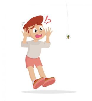 Chłopiec boi się pająka.
