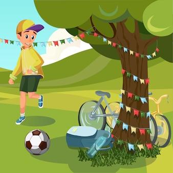 Chłopiec cartoon zagraj w grę w piłkę nożną w parku