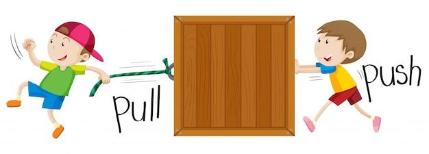 Chłopiec ciągnąc i popychając drewniane pudełko