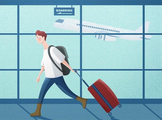 Chłopiec ciągnący walizkę