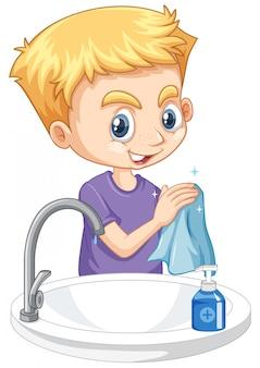 Chłopiec cleaning ręki na białym tle