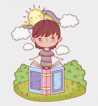 Chłopiec czyta książkę z słońcem i tęczą