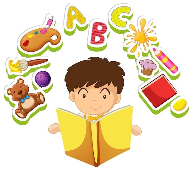 Chłopiec czytający książkę z zabawkami w tle