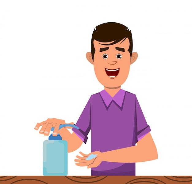 Chłopiec dezynfekuje ręce żelem