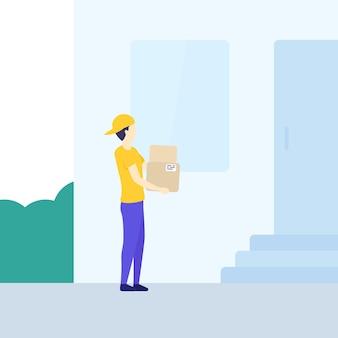 Chłopiec dostawczy trzymający pudełka przed domem