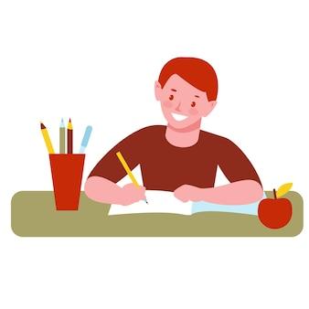 Chłopiec dziecko odrabiania lekcji, pisze w zeszycie.