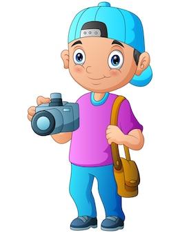 Chłopiec fotograf kreskówka trzymając aparat