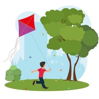 Chłopiec gra latawca.