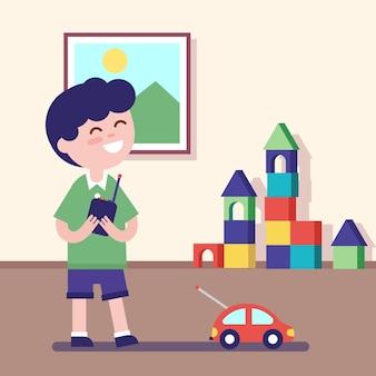 Chłopiec gra z zdalnie sterowanym samochodem
