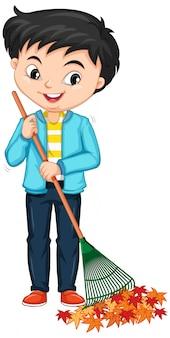 Chłopiec grabienie liści